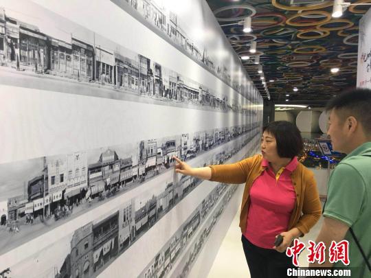 上千幅今昔对比老照片展出见证北京四十年巨变